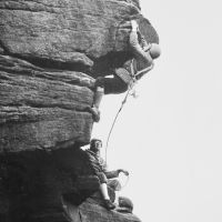 02 Bowden Black leads Hardings Superdirect Finish, Stanage (belayer possibly John Wild), early 1970s