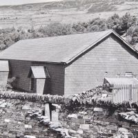 10 Ty Powdwr early days - with complete stockade wall and gates (Derek Seddon Collection)
