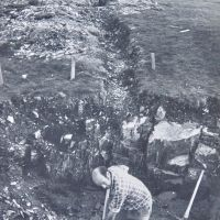 12 John Castick at work on septic tank excavations, Phil Kendell behind in discharge trench (note original compound wall at full height) (Derek Seddon Collection)