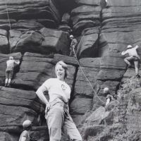 14 Sandy Gregson at Stanage - KMC Sponsored Climbing Day fund-raising event 1974 (during which 130 routes were soloed by Alf Gleadell & John Whittle) (Derek Seddon Collection)