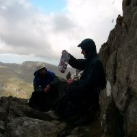 A soggy lunch atop Grooved Arete, Tryfan (Colin Maddison)