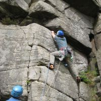 James W setting off up Agony Crack HVS 5a (Roger Dyke)
