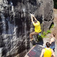Mark working hard of the small starting holds of a Red problem at Bas Cuvier (Daniel O'Brien)
