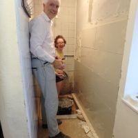 Dave W & Emily happily tiling the ladies' shower