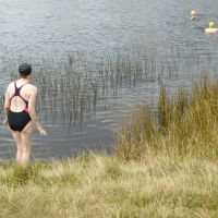 Christine contemplating the 13 degree water at Tarn at Leaves (Virginia Castick)