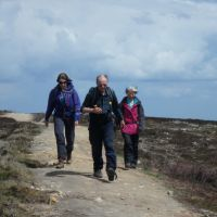 Striding down the Dukes Road path across Broomhead Moor