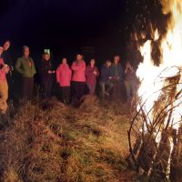 Nine girls and three Daves enjoying the bonfire.
