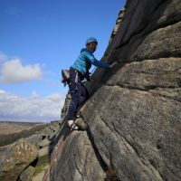 Caroline following Tom on the initial slab of Flying Buttress (Andy Stratford)